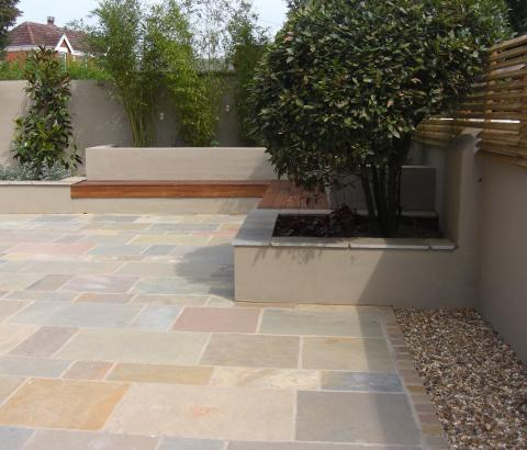 Contemporary Limestone Terrace with Hardwood seat and planter