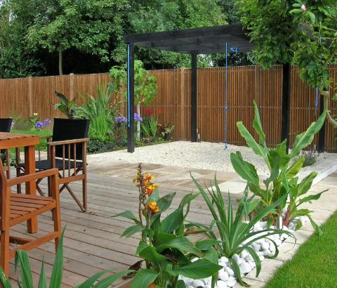 Entertaining area with decking, pergola and planting